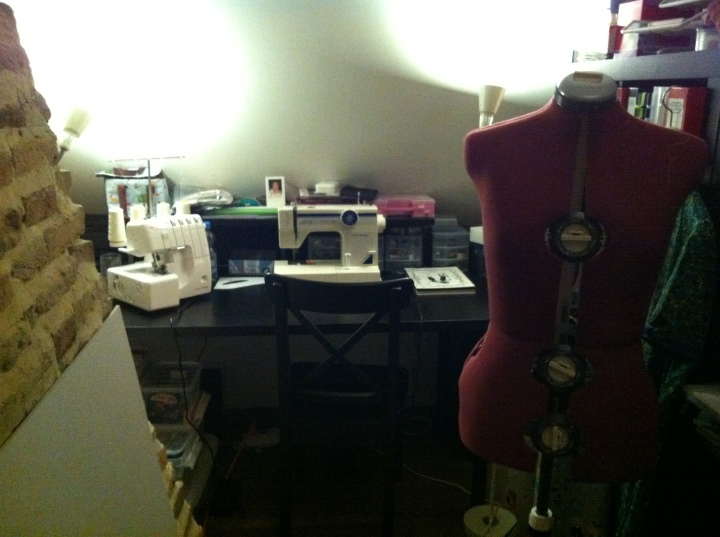 My own personal sewing space. I'm comfortable like that, only need my dining table to cut fabric. When we move, my boyfriend promised me an entire room :) I feel very installed with my sewing machine and the serger I got from my parents and godparents for my birthday... And the mannequin my boyfriend got me for my birthday as well :) It makes life so much easier!